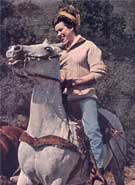 color photo of Jane on a horse